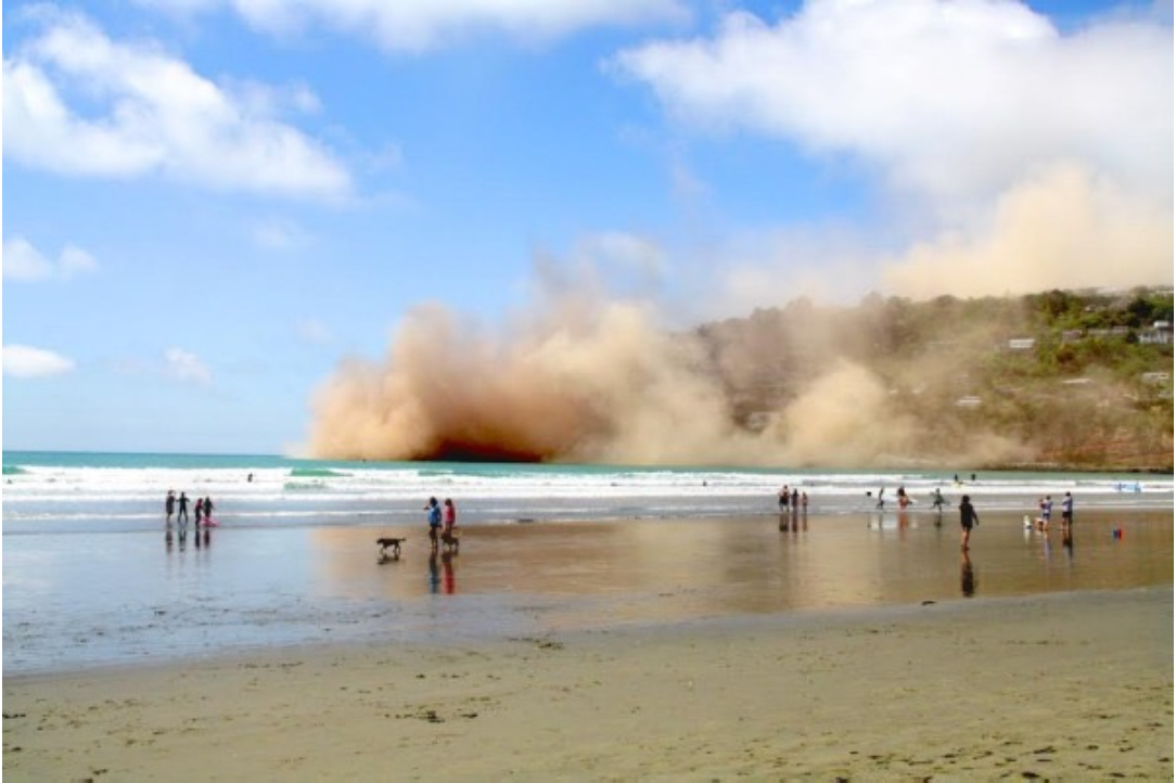 Dust clouds formed after large cliffs collapsed in the coastal community of Sumner following the magnitude-5.7 earthquake. Photo by Graeme Jolliffe