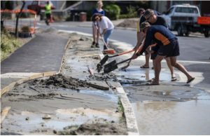 Once again, cleanup of liquefaction had to be done in many of Christchurch's eastern suburbs. In some cases, streets resealed only days prior, for the first time since the February 2011 earthquake were once again destroyed. However, in true kiwi fashion everyone came and helped out. Photo by Iain McGregor.