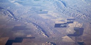 An aerial photograph looking southwest over both the Coalinga and Kettleman Hills folds