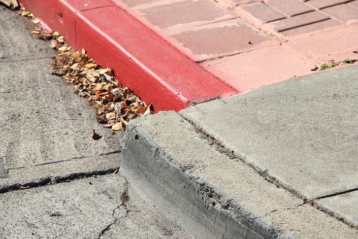 This picture from the New Yorker shows evidence of creep along the Hayward Fault. Because the fault is not completely locked, there is movement in the absence of earthquakes. Evidence such as this is visible throughout the East Bay in sidewalks, buildings, and roads.