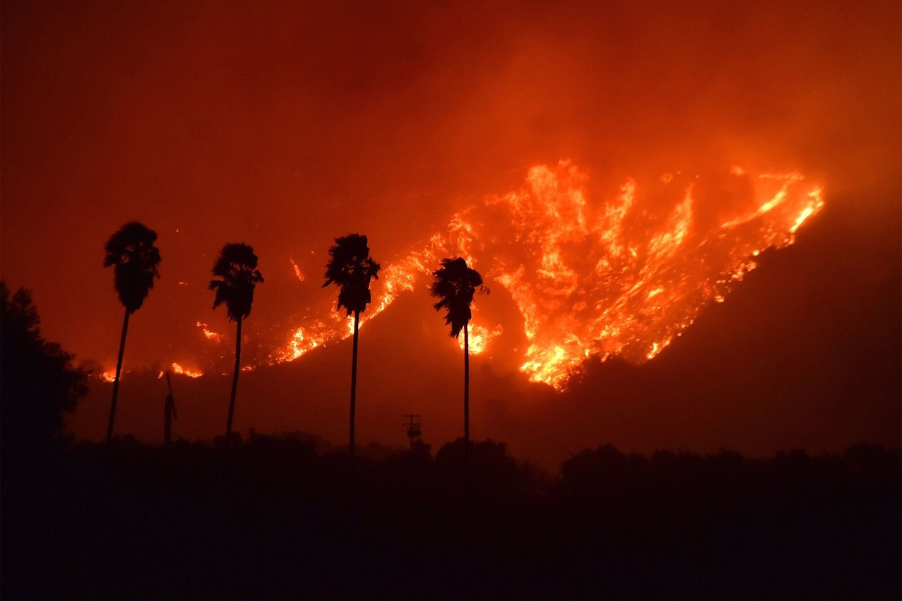 Strong wind and steep terrain have prevented the fires around Los Angeles from being contained more. (Photo from the Wall Street Journal)
