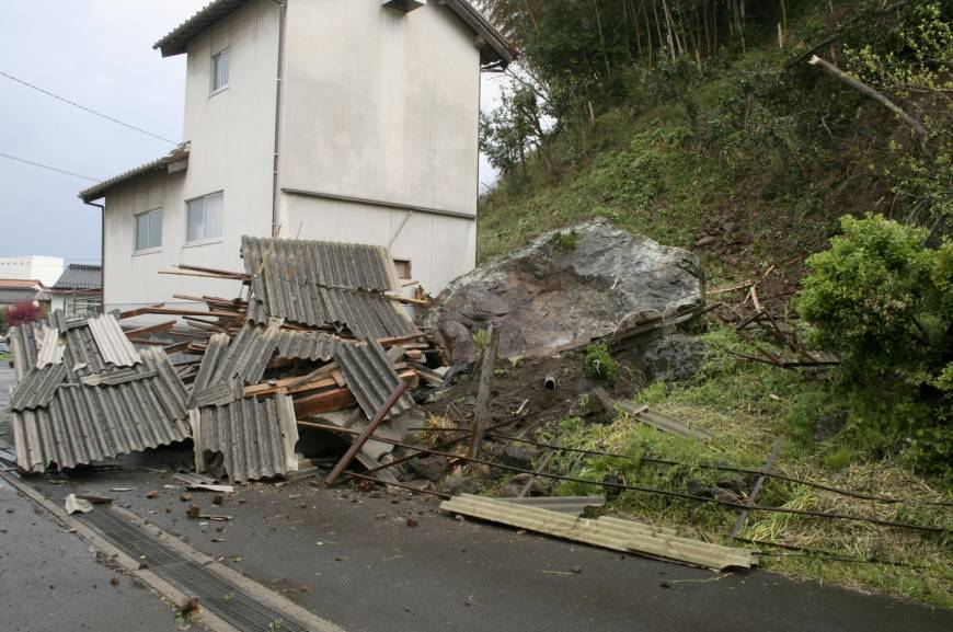 This picture shows a small landslide triggered by Monday's earthquake in near the town of Oda. (Photo from: KYODO)
