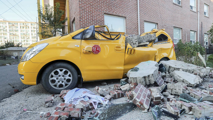 This photo shows some damage sustained in the November 2017 M=5.4 earthquake just west of the city of Pohang. In total, 90 people were injured and $52 million in damage was caused. (Kim Jun-beom/Yonhap)
