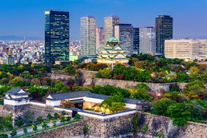 Osaka, Japan - November 20, 2015: Overlooking Osaka Castle Park at dusk. The castle dates from 1583 and the most recent reconstruction was completed in 1997.