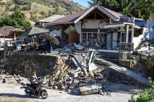 Sunday's M=6.9 earthquake on the Indonesian island of Lombok comes just a week after a M=6.4 event claimed 16 lives. At least 98 people are reported to have died in yesterday's event. (Photo from: Antara Foto/Reuters)