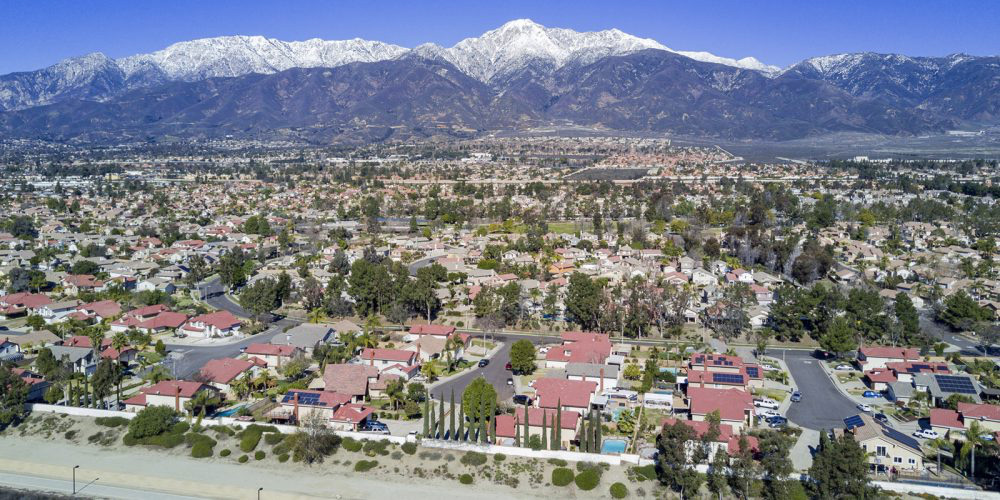 The Sierra Madre range rises above Rancho Cucamonga, jacked up by successive earthquakes on the Sierra Madre Fault etched into its base.