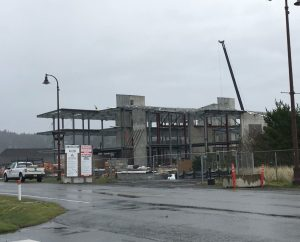 "The OSU Marine Science building under construction, April 2019. It's on a sandbar at sea level in Newport, Ore., and can be overtopped by the largest of the modeled tsunamis, as well as battered by the NOAA ships docked just to the left out of the frame. It's not often you can take the ""after"" picture ahead of time, but this is what it may look like after being destroyed by the next tsunami. Credit: Chris Goldfinger."