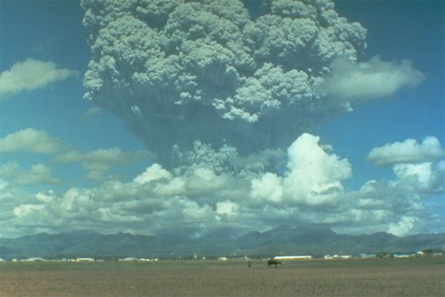 Clouds of volcanic ash and gas rise above Mount Pinatubo, Philippines, June 12, 1991, three days before the cataclysmic eruption. Credit: USGS