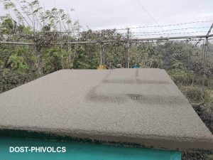 Ash accumulation on a rooftop can lead to collapse. Credit: PHIVOLCS