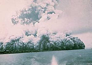 In 1965, Taal erupted, leading to the recognition of base surges during volcanic eruptions. According to volcanocafe.org, this photo was taken by the geologist responsible for seismic monitoring. He fled by boat, and took this picture looking back. Credit: volcanocafe.org