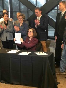 Governor Kate Brown signs a proclamation declaring Cascadia week. Credit: Douglas Toomey