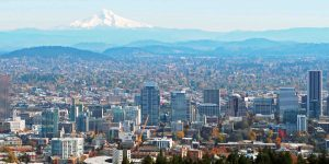 Downtown Portland skyline with Mt. Hood in the background. Photo Credit: Truflip99 (CC BY-SA 4.0)