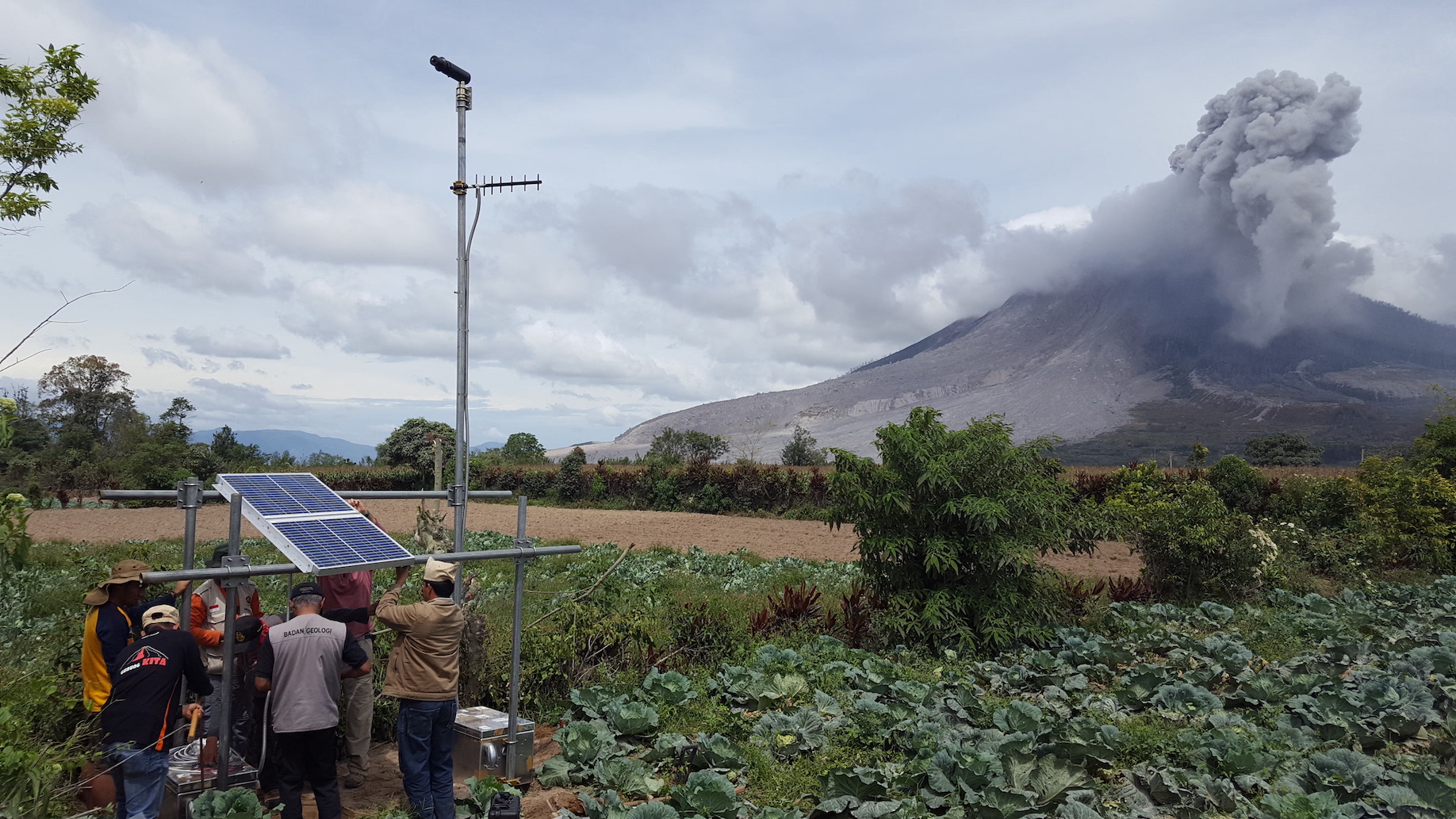 Installation of a telemetered, solar-powered scanning spectrometer in 2016 at Sinabung volcano in Sumatra, Indonesia. The instrument measures the amount of sulfur dioxide gas emitted from the volcano, which helps forecast volcanic activity. Credit: USGS