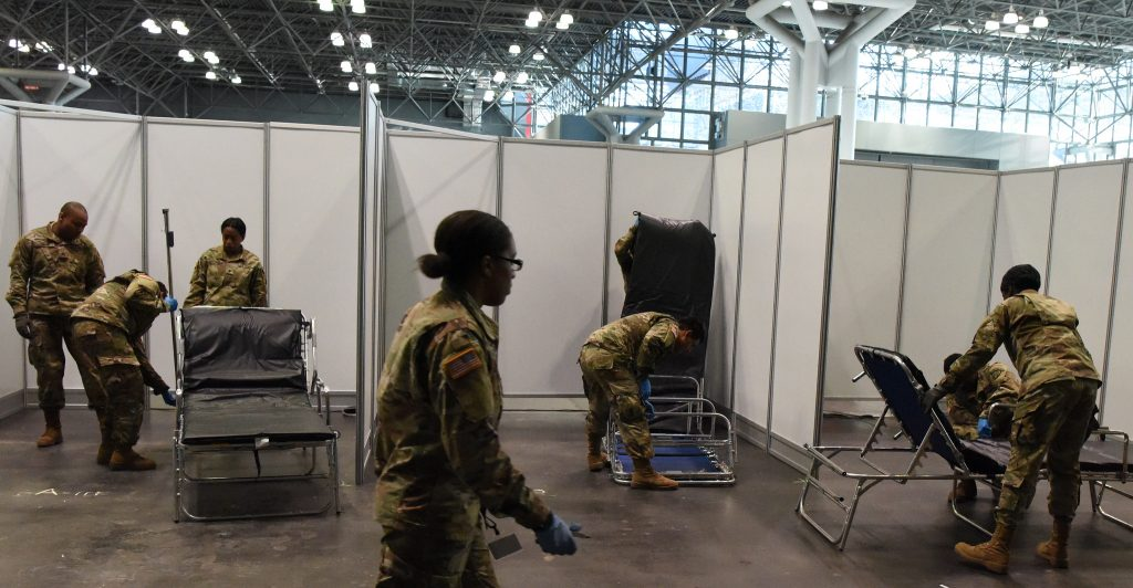 "The New York National Guard is setting up hospital ""rooms"" in the Javits Center to ease the hospital bed shortage in the city. Credit: U.S. Air National Guard photo by Senior Airman Sean Madden"