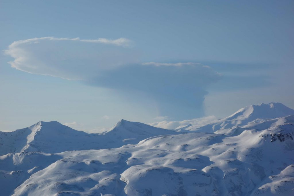 Plume from Bogoslof on February 19, 2017, seen from Unalaska Island, 53 miles east-southeast of the volcano. This photo, captured from a helicopter during fieldwork by the Alaska Volcano Observatory, was taken 14 minutes after this particular explosive event began. Credit: Janet Schaefer and the Alaska Volcano Observatory / Alaska Division of Geological & Geophysical Surveys