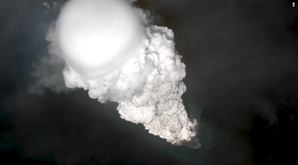 Worldview satellite image collected May 28, 2017, showing the initial development of an ash plume shooting 40,000 feet (12 kilometers) skyward during the 2016-2017 eruption at Bogoslof. This image was captured just after the plume rose above the atmospheric freezing level of water, and 2 minutes before production of detectable lightning. The white color toward the top of the column indicates a large amount of condensed water and ice. This abundant water comes from the ocean under which the vent is submerged. Image provided under a Digital Globe NextView License. Credit: Dave Schneider and the Alaska Volcano Observatory/USGS.