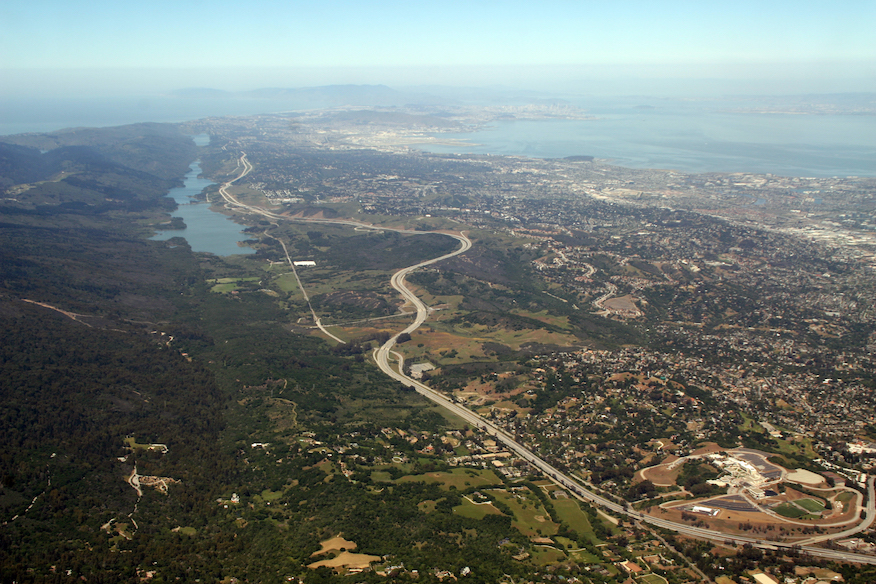 The San Francisco Peninsula is home to the San Andreas Fault — seen here running beneath the reservoirs in the left of this northward view — along with more than 1.6 million people. Credit: Doc Searles (CC BY-SA 2.0).