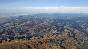 Aerial view of the Calaveras Reservoir, looking to the east. Calaveras Dam is located on the left (north) edge of the reservoir in the photograph. Credit: Dicklyon (CC BY-SA 4.0)