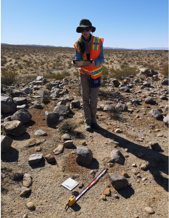 Zuckerman measuring rock displacement in the Mojave desert