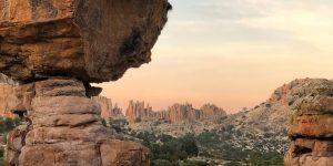 Photo of a precariously balanced rock.