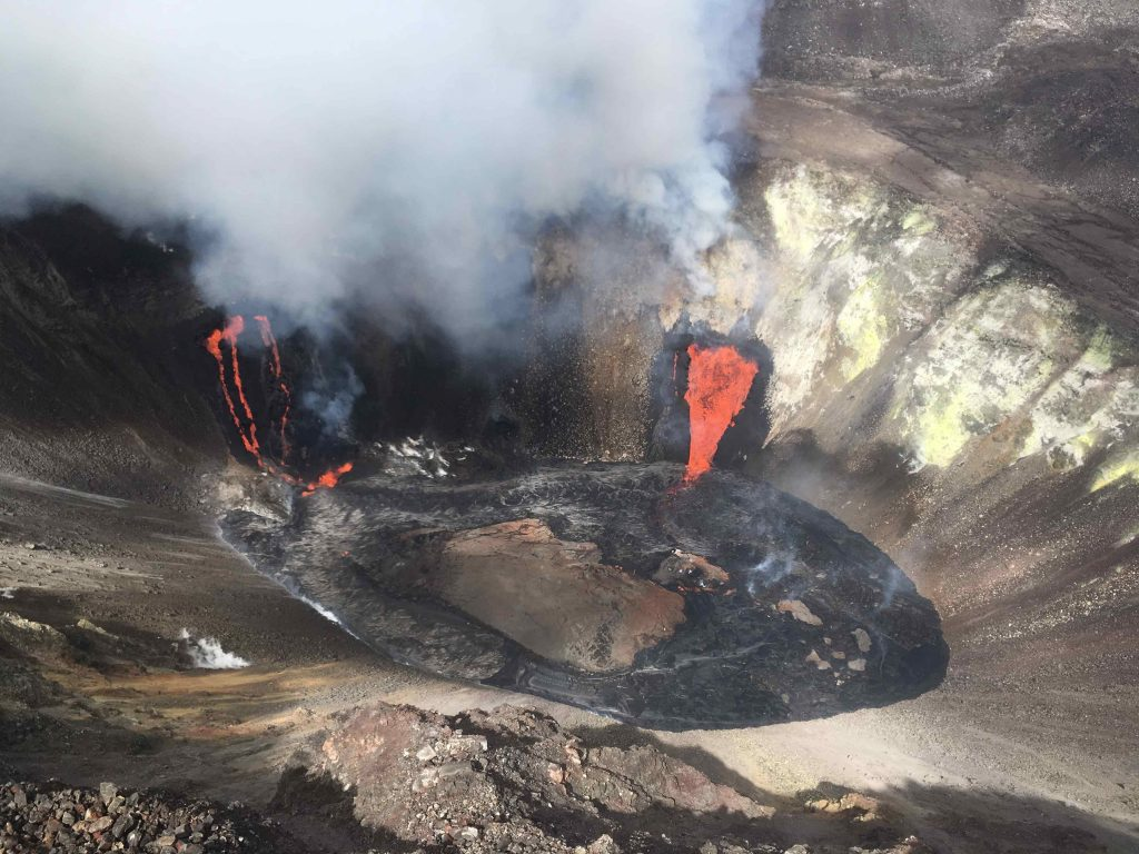 Aerial view of the Kīlauea summit on Dec. 21, showing the two fissures pouring lava into the growing lava lake. As of the morning of Dec. 22, the lava lake had already filled 134 meters (440 feet) of the bottom of Halema'uma'u crater in the summit caldera. Credit: M. Patrick, USGS