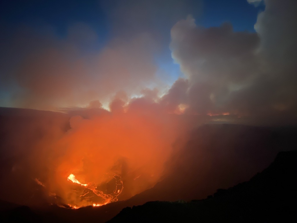 Just a couple of days ago, a water lake filled the bottom of the Halema'uma'u crater. Now, a glowing lava lake does, filling the skies with gases and fog. Credit: USGS