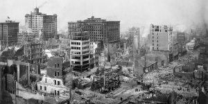 Black and white photo of damaged city buildings