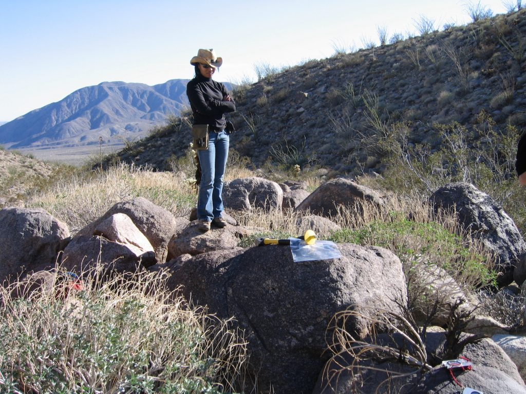 Person standing on a boulder