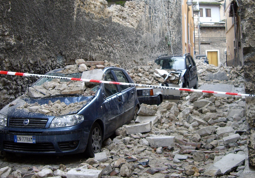 Cars crushed beneath rubble