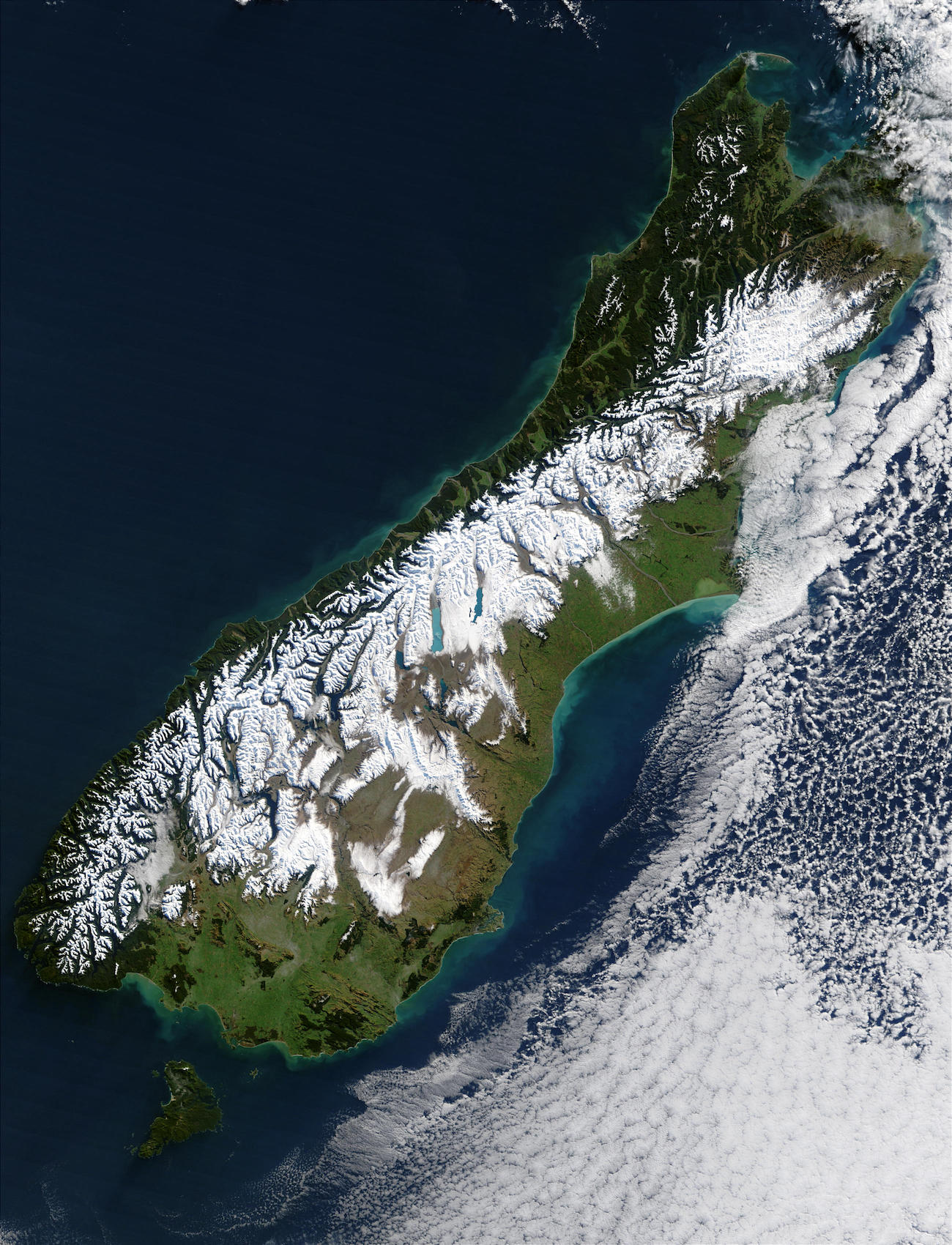 Satellite image of island partly covered with snow