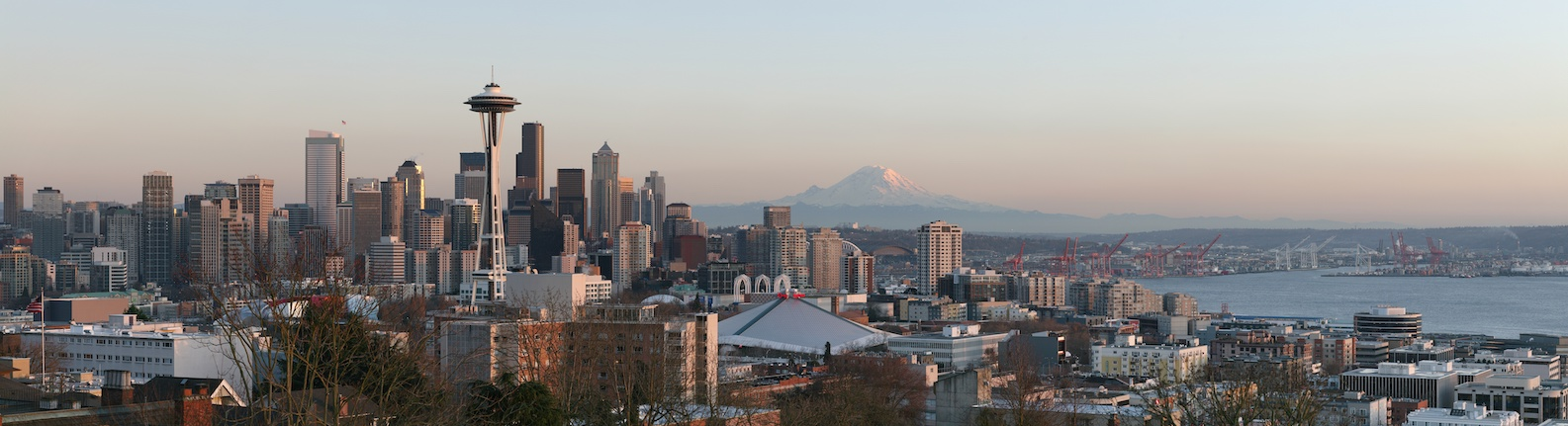 Photo of cityscape with volcano in the background