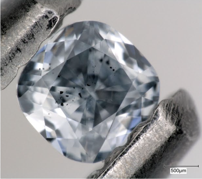 This close-up view of a super-deep diamond highlights the inclusions, seen here as black spots. Inclusions like these provide geochemical evidence that subducted oceanic plates can carry water and other fluids deep into the mantle.Credit: Photo by Evan Smith/© 2021 GIA