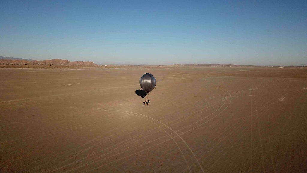 Researchers walk the balloon across the desert. Credit: NASA/JPL-Caltech