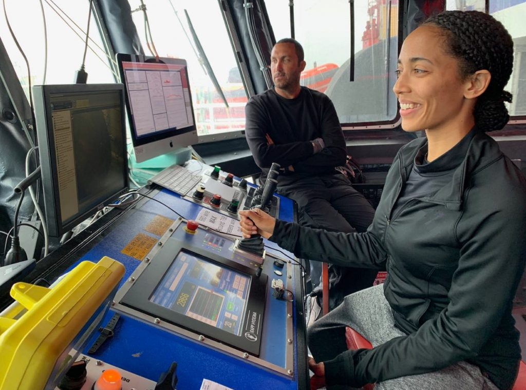 """Christine Chesley and Eric Attias operate the Scripps Undersea Electromagnetic Source Instrument (SUESI) during a deep-tow. SUESI is attached to the ship via a coaxial cable and must be """"flown"""" about 100 meters above the seafloor. Credit: Kerry Key"""