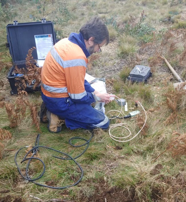 Wayne Peck of the Seismology Research Centre installing a station for the temporary aftershock network near Woods Point. Credit: Jake Wilcox