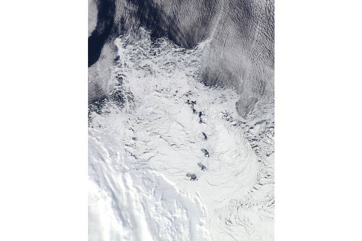 Chain of islands surrounded by white ice